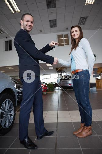 Man shaking hand with woman