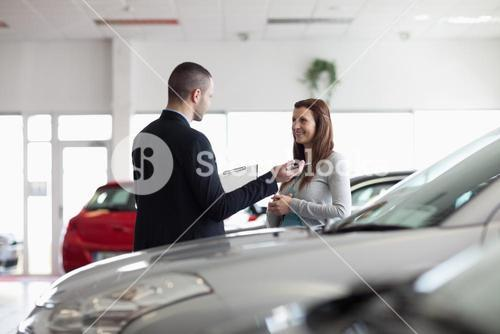 Dealer speaking with a client
