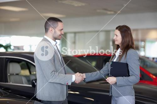 Businesswoman shaking hand of a man