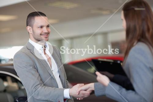 Businesswoman shaking hand of a client