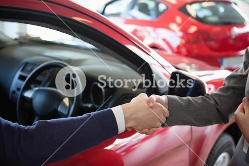 Close up of a man shaking hand to a woman
