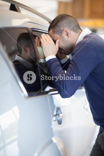 Customer looking inside a car