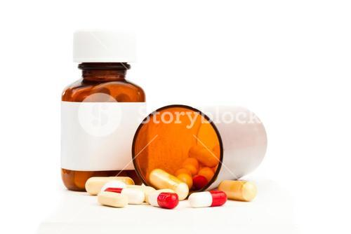 Container of medications knocked over