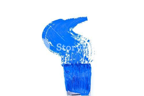 Blue brush stroke forming a zigzag against a white background