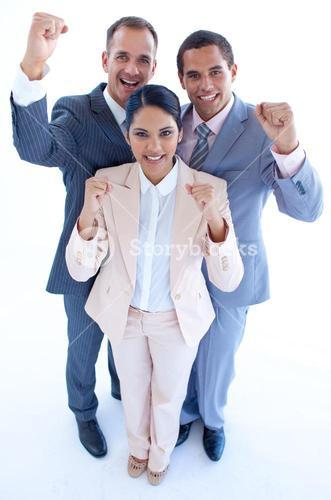 Happy business team celebrating a success with arms up