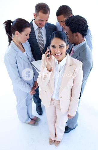 High angle of businesswoman on phone in front of her team