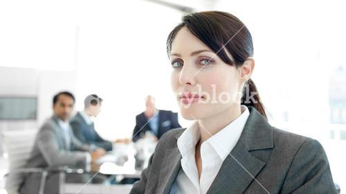 Close up of a businesswoman in a wheelchair during a meeting