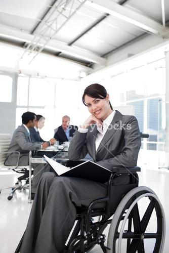 Portrait of a smiling businesswoman in a wheechair