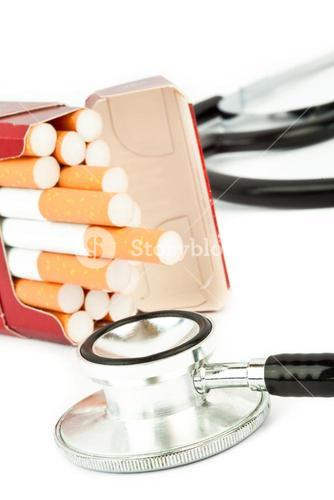 Cigarette pack next to a stethoscope