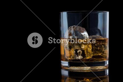 Tumbler glass with whiskey