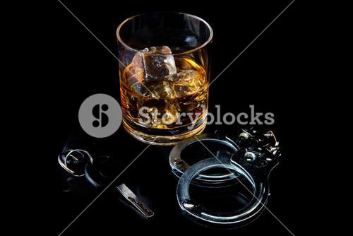 Whiskey on the rocks with handcuff and car key