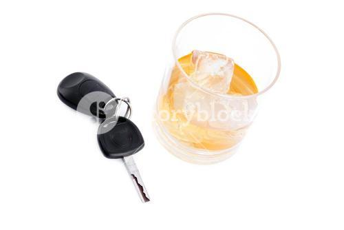 Car key next to a whiskey