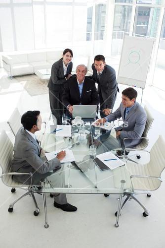 Business people working at a computer in a meeting
