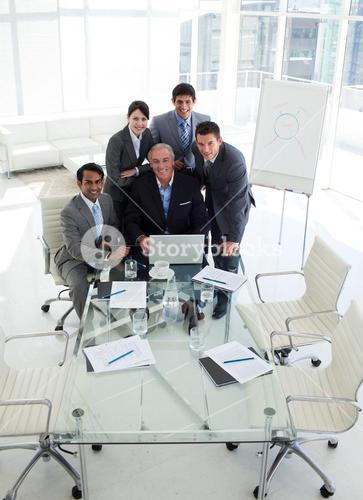 A business group showing diversity working at a computer