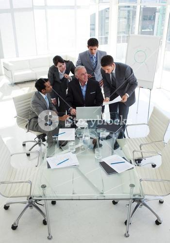 Businessman showing document to his senior manager