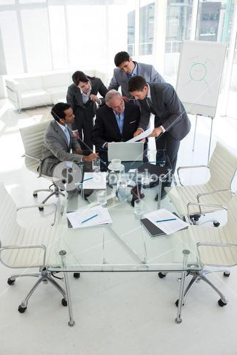 Business people looking at a document