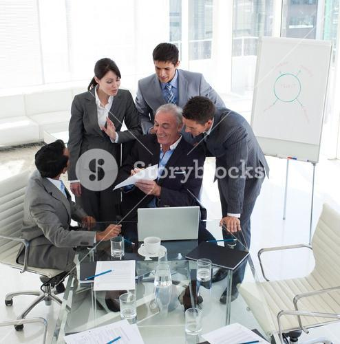 Smiling manager pointing at a contract in a meeting