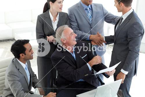 Businessman closing a deal after studying a contract
