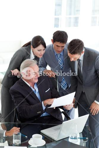 Manager showing document to his team