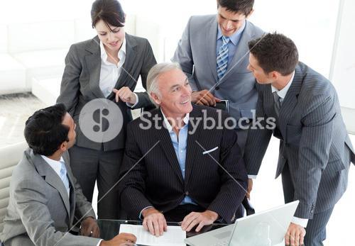 Confident business team discussing a contract