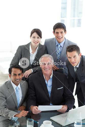 Senior manager holding a paper in a meeting
