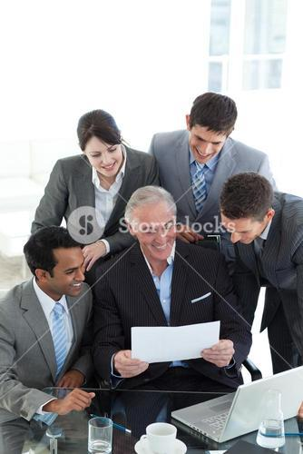 Businessman showing a contract to his team