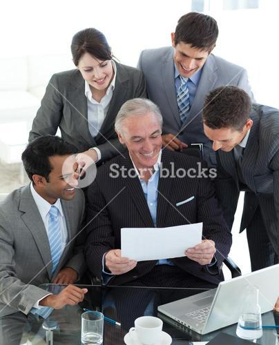 Senior manager showing a document to his team