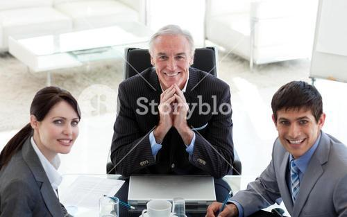 Business people and their manager in a meeting