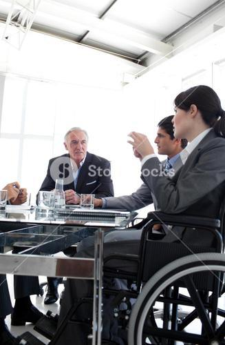 Attractive businesswoman in a wheelchair during a meeting