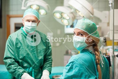 Two surgeon wearing surgical equipment