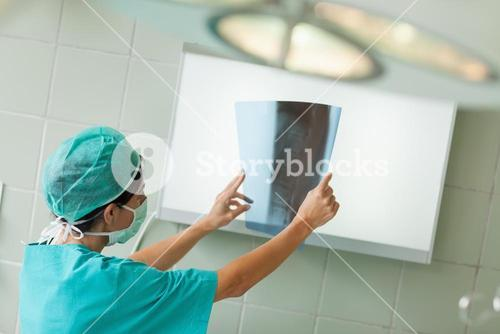 Surgeon looking at a radiography