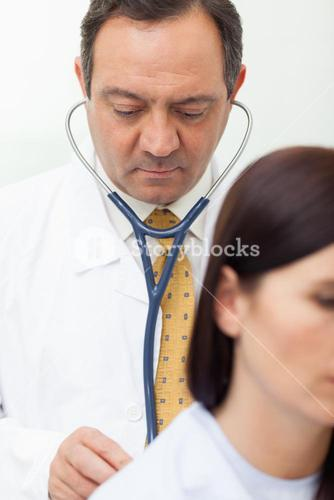 Doctor auscultating a patient
