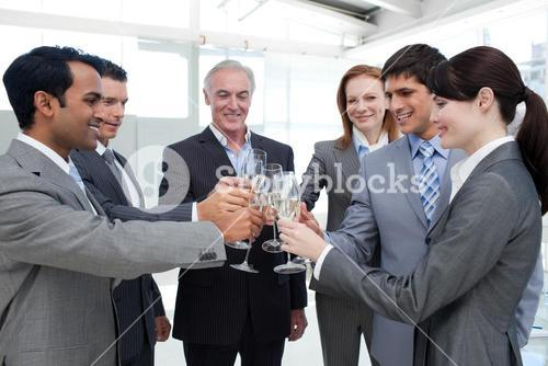 Cheerful business team toasting with Champagne