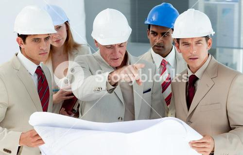 Engineers studying plans
