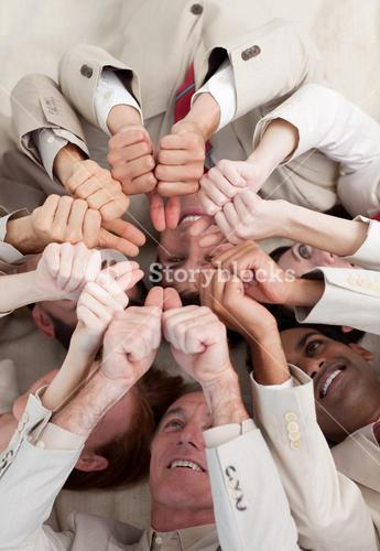 Business people with thumbs up lying on the floor