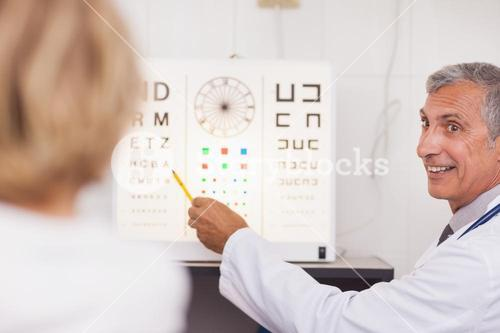 Doctor doing an eye test on a patient in a hospital