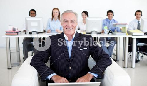 Senior manager using a laptop