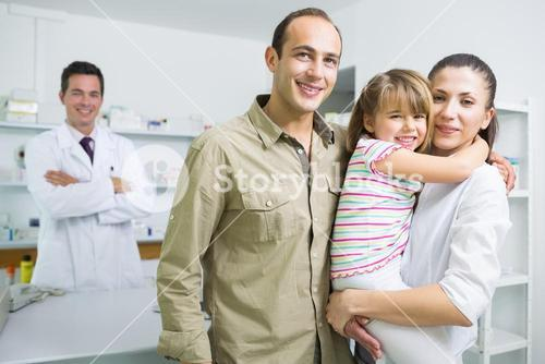 Smiling family and a pharmacist