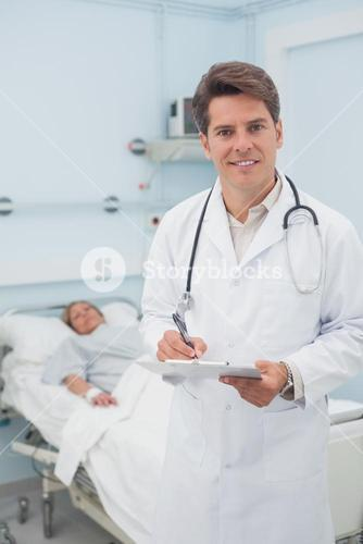 Doctor holding a chart while smiling