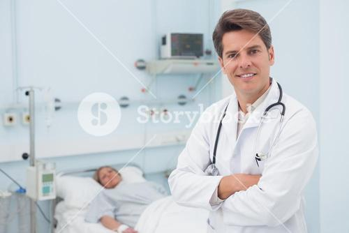 Doctor smiling with crossed arms