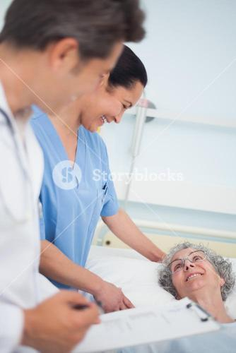 Patient laughing with a nurse and a doctor