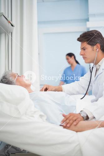 Doctor auscultating a patient with a stethoscope
