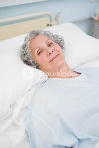 Patient looking at camera on a bed