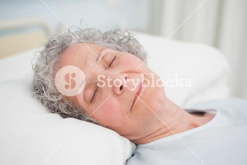 Patient sleeping on a medical bed