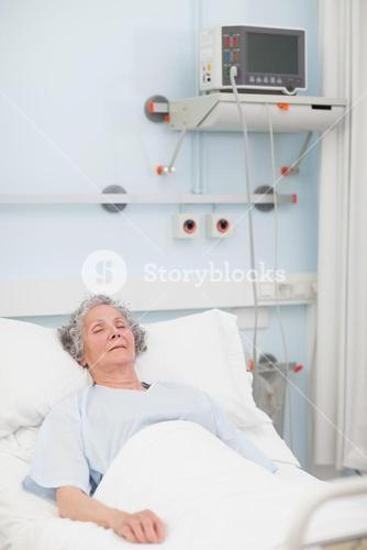 Elderly patient lying with closed eyes
