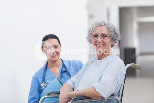 Patient in a wheelchair next to a nurse