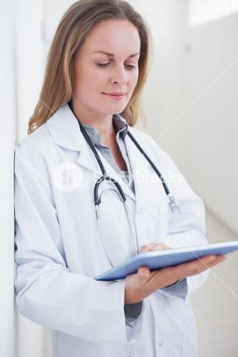 Doctor holding a tablet computer