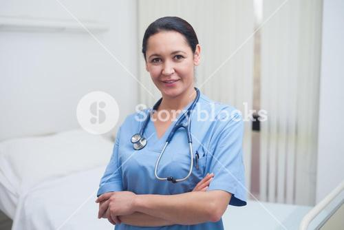 Nurse standing with crossed arms