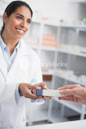 Pharmacist giving a drug box to someone