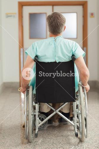 Male patient sitting in a wheelchair